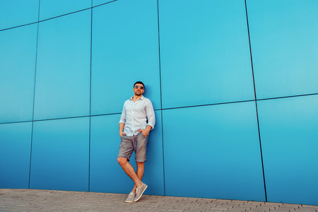 street shot: Full length portrait of a caucasian masculine man wearing Casual street style clothes. Copy-space. Outdoor shot