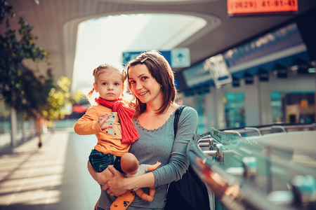 or spree: Happy smiling mother with her daugther in the shopping mall. Stock Photo
