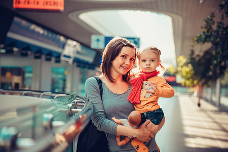 daugther: Happy smiling mother with her daugther in the shopping mall. Stock Photo