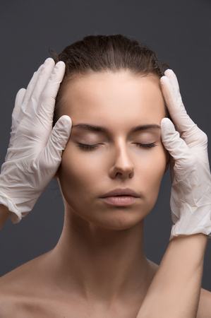 Portrait of young woman getting cosmetic injection. Clean Beauty. 免版税图像 - 51311792