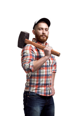 baseball sport: Redhead Bearded man wearing a baseball cap and shirt holding a hammer on a shoulder with an expression.