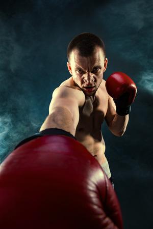 pugilist: man wearing boxing gloves Stock Photo