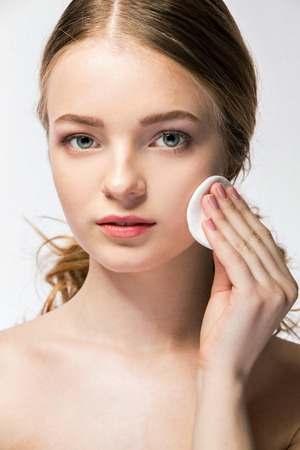 beautycare: beauty concept of young woman with sponge and clean perfect skin looking at camera Stock Photo