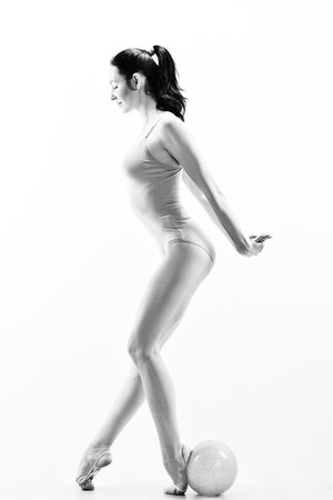 slim women: Young girl engaged art gymnastic with ball