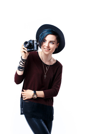 Portrait of smiling blue-haired girl in hat taking shot with film camera.Isolated Stock Photo