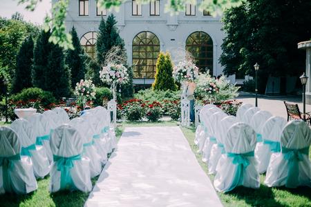 set up: Beautiful wedding day ceremony set up. Outdoor. Stock Photo