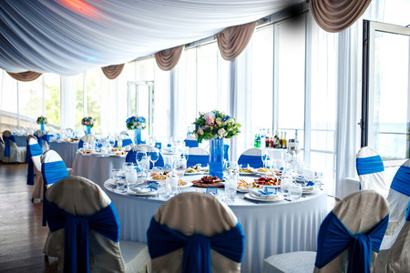 set up: Beautiful wedding day ceremony set up. Indoor. Good served table in a restaurant.