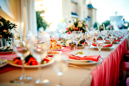 set up: Beautiful wedding day ceremony set up. Outdoor. Served table in a restaurant.