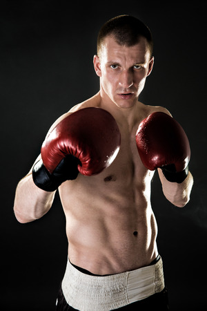 Muscular kickbox or muay thai, boxing fighter. Portrait.