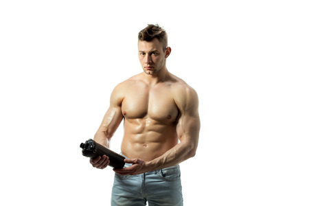 sexy pose: Muscular man with protein drink in shaker over white background Stock Photo