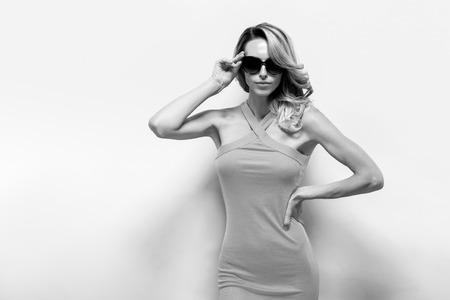 blackwhite: Beautiful blonde model in dress posing at camera Stock Photo