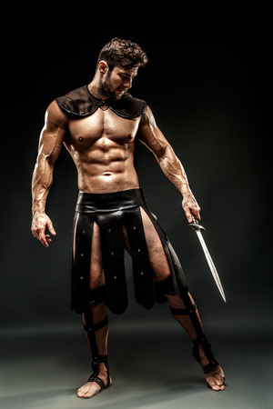 Severe barbarian in leather costume with sword Stockfoto