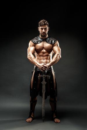Severe barbarian in leather costume with sword Archivio Fotografico