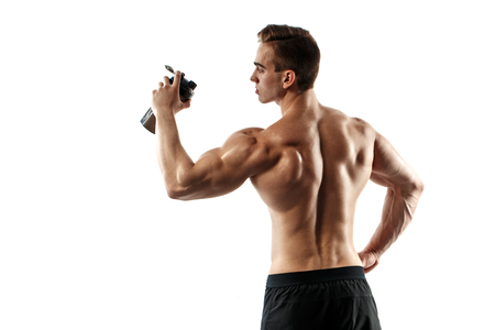 Muscular man with protein drink in shaker over white background Stock Photo