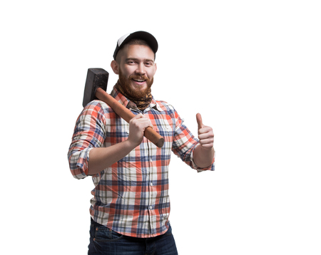 Redhead Bearded man wearing a baseball cap and shirt holding a hammer with an expression. Thumbs Up. Smile.