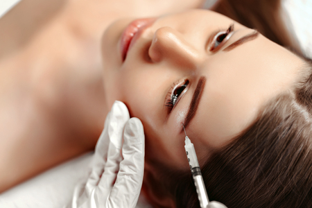 Portrait of woman getting cosmetic injection. Clean Beauty.