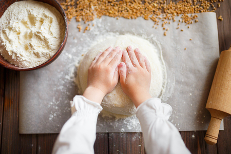cutter: Detail of hands kneading dough