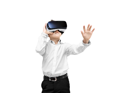 simulation: Kid in formal outfit wearing VR glasses putting hands out in excitement isolated on white background.