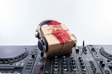 A present laying on mixing table. Horizontal indoors shot Stock Photo