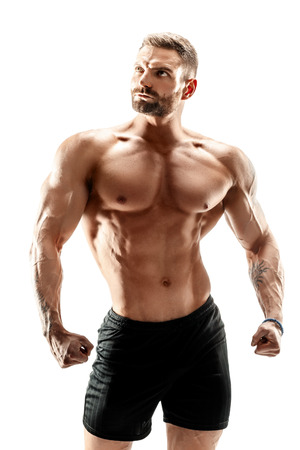 muscular super-high level handsome man posing on white background.