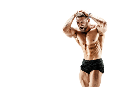 Handsome muscular shirtless man screaming while flexing his musclues isolated on white.