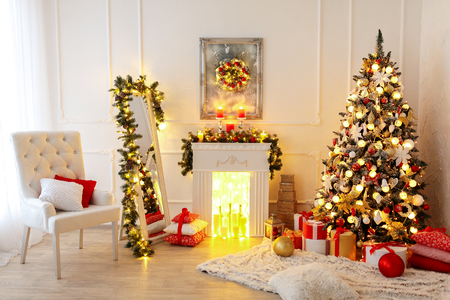 Christmas Room Interior Design, Xmas Tree Decorated By Lights Presents Gifts Toys, Candles And Garland Lighting Indoors 版權商用圖片