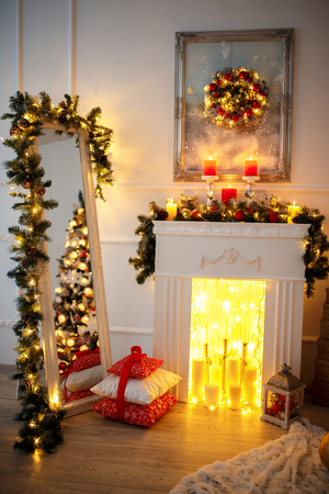 Christmas Room Interior Design, Xmas Tree Decorated By Lights Presents Gifts Toys, Candles And Garland Lighting Indoors Stock Photo