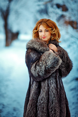 emotionally red heared woman in coat outdoor
