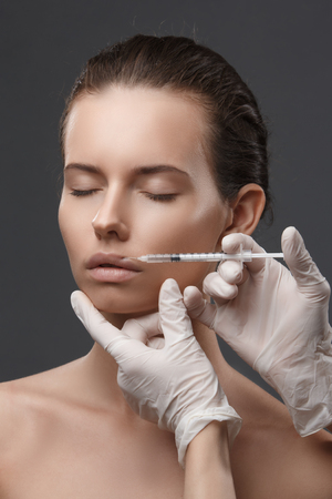 Portrait of young woman getting cosmetic injection. Clean Beauty.  Closed eyes.