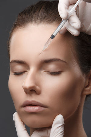 Portrait of young woman getting cosmetic injection. Clean Beauty. Фото со стока - 93112134