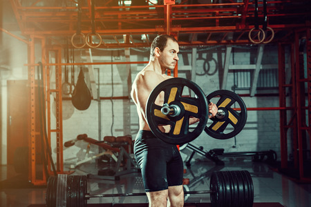 Athlete training biceps in a gym. Functional training workout Stock Photo
