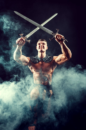 Aggressive expressive warrior crossing swords above head posing in smoke.