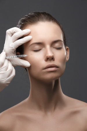 Portrait of young woman getting cosmetic injection. Clean Beauty.  Closed eyes. Фото со стока - 95851564