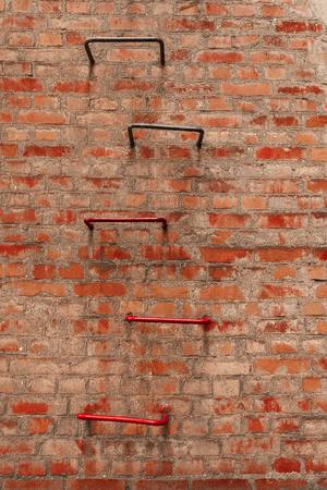 dirty red brick wall and ladder. retro. Ukraine