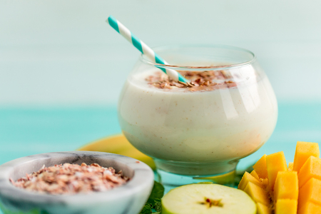 Overnight Oats with Mango and banana, apple on wooden table Stock Photo