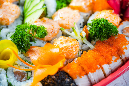 Close up of a Various kinds of sushi rools food