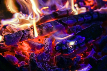 Burning firewood in the fireplace close up, BBQ fire, charcoal background. Charcoal fire with sparks Stock Photo - 107353565