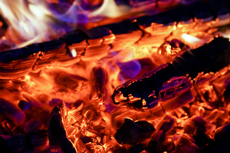 Burning firewood in the fireplace close up, BBQ fire, charcoal background. Charcoal fire with sparks Reklamní fotografie