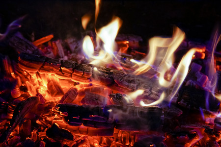 Burning firewood in the fireplace close up, BBQ fire, charcoal background. Charcoal fire with sparks Stock Photo - 107353746