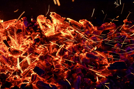 Burning firewood in the fireplace close up, BBQ fire, charcoal background. Charcoal fire with sparks Stock Photo - 110902393