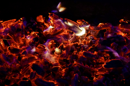 Burning firewood in the fireplace close up, BBQ fire, charcoal background. Charcoal fire with sparks Stock Photo - 110901992