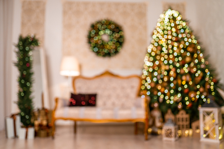 Christmas home room with tree and festive bokeh lighting, blurred holiday background Stock Photo