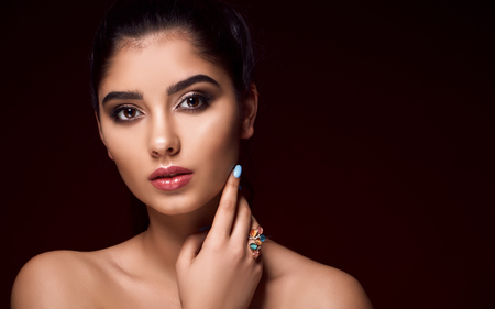 Classic close up vogue beauty portrait with professional make up and hairstyle beautiful girl in studio lights.