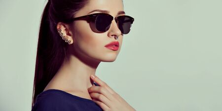 Fashion Lady stylish Swag Accessories. Eyeglasses and Jewelry. Stock Photo