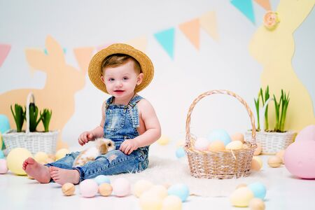 the boy with the rabbit. happy little boy in hat holding cute fluffy Bunny. Friendship with Easter Bunny. Spring photo with little boy with his Bunny. boy is holding a cute little rabbit.