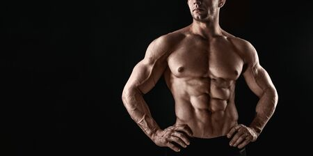 Unrecognizable Strong Athletic Sexy Muscular Man on Black Background. 写真素材