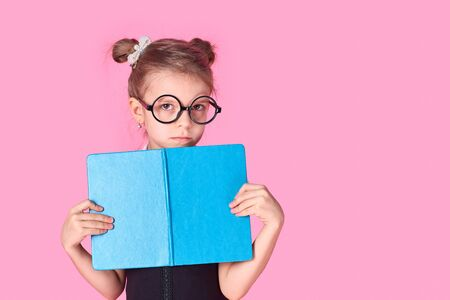 Portrait of her she nice foxy lovely attractive cheerful positive school girl holding in hands hiding behind opened book exam preparation isolated over pink background.