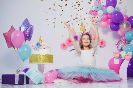 Unicorn Girl throws confetti. Idea for decorating unicorn style birthday party. Unicorn decoration for festival party girl.
