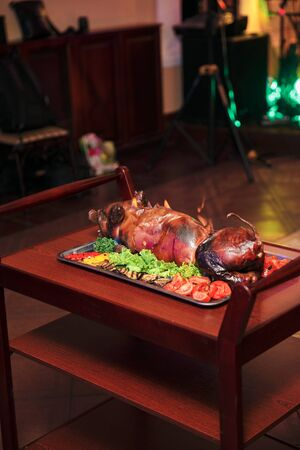 young roasted piggy pig being served at the celebration.