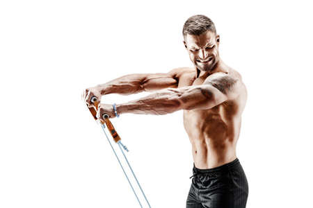 Handsome muscular strong man doing pulling exercise and working hard. Imagens